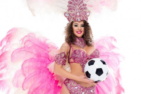 woman in carnival costume holding football ball in hands, isolated on white