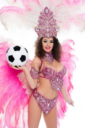 woman in carnival costume holding football ball in hand, isolated on white