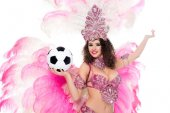 woman in carnival costume holding football ball in hand and looking at camera, isolated on white