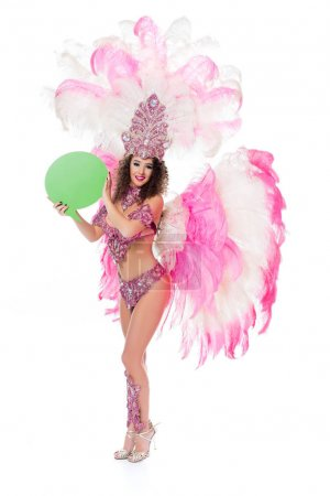 woman in carnival costume holding blank green text balloon, isolated on white