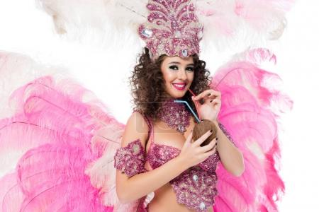 woman in carnival costume holding coconut with straws, isolated on white
