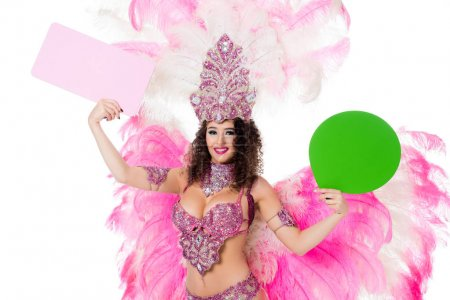 woman in carnival costume holding blank green text balloon and pink banner, isolated on white