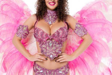 cropped image of of woman in carnival costume with hands on waist, isolated on white