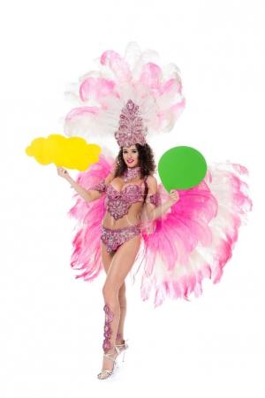 woman in carnival costume holding yellow empty text balloon and another one green, isolated on white