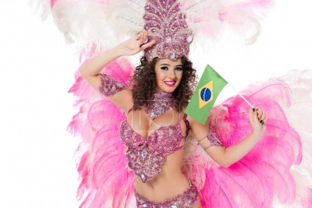 smiling woman in carnival costume holding brazilian fllag in hand with hand on forehead, isolated on white
