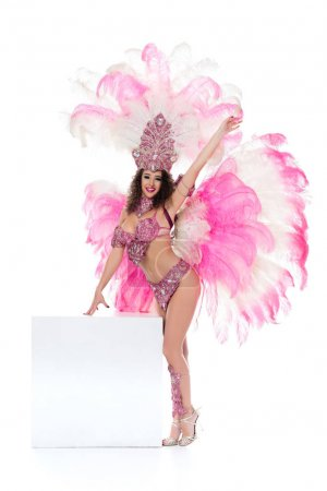 caucasian woman in carnival costume standing near white blank square with arm raised, isolated on white