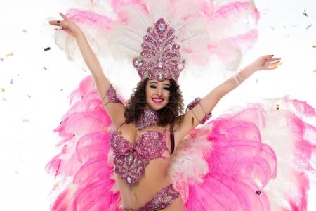 Happy woman in carnival costume standing with arms outstretched, isolated on white