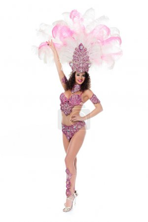 Happy young woman in carnival costume with pink feathers isolated on white