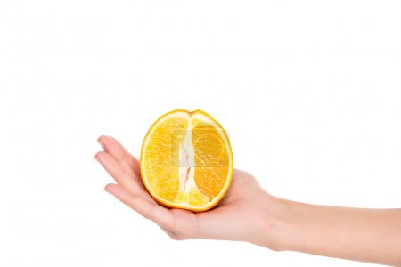 close-up partial view of woman holding half of fresh ripe orange isolated on white