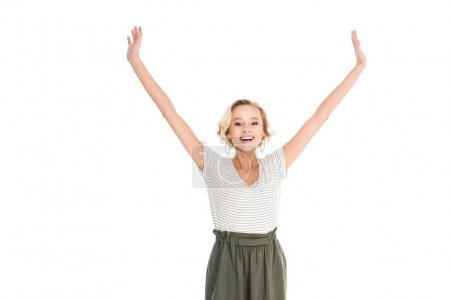 beautiful happy young woman standing with raised hands and smiling at camera isolated on white