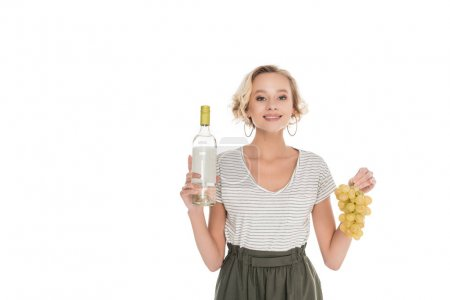 portrait of smiling woman with bottle of wine and grapes in hands isolated on white