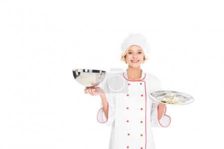 portrait of smiling female chef with empty serving tray and money looking at camera isolated on white
