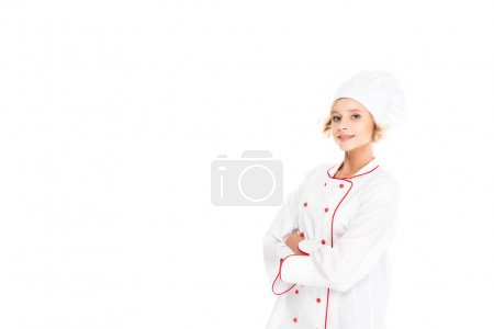 Photo for Portrait of smiling female chef with arms crossed looking at camera isolated on white - Royalty Free Image