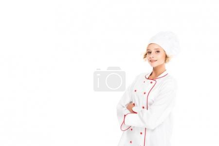 portrait of smiling female chef with arms crossed looking at camera isolated on white