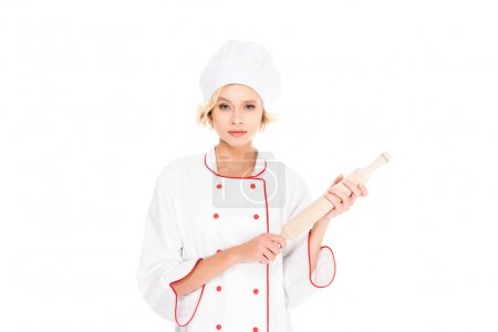 portrait of young female chef with rolling pin in hands isolated on white