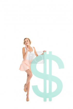 beautiful smiling woman standing near blue dollar sign isolated on white