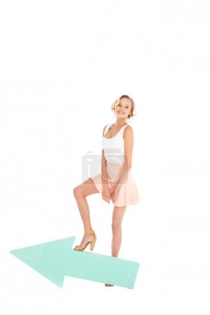smiling young woman with arrow isolated on white