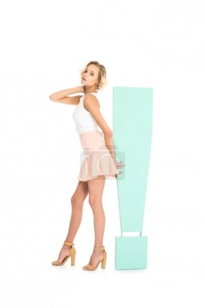 beautiful young woman with big exclamation mark isolated on white