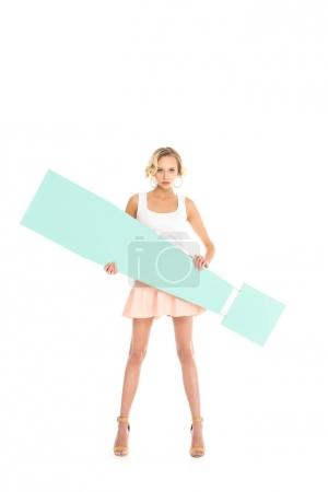 beautiful young woman holding big exclamation mark isolated on white
