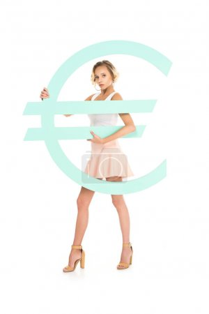 beautiful young woman with big euro sign looking at camera isolated on white