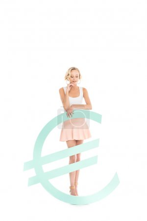 pensive woman standing near euro sign isolated on white