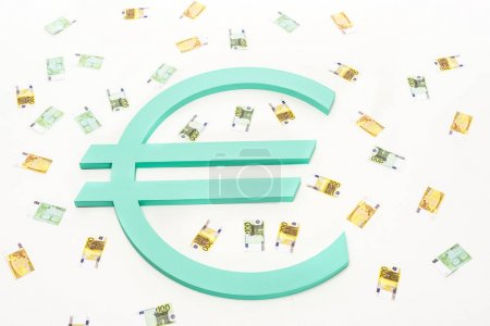 close up view of banknotes and euro sign isolated on white