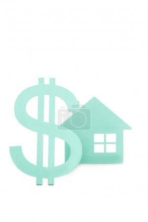 close up view of dollar sign and house model isolated on white