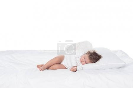 little baby angel sleeping on bed, isolated on white