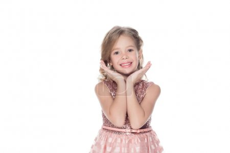 adorable smiling child in pink dress, isolated on white