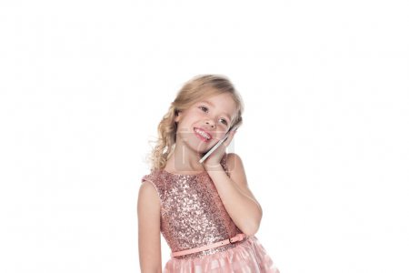 smiling child talking on smartphone, isolated on white