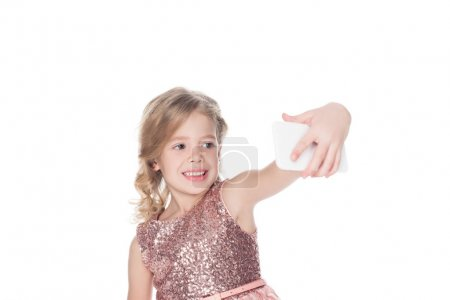happy kid taking selfie on smartphone, isolated on white