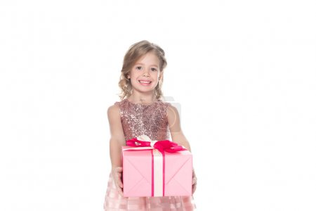 cheerful kid in dress with sparkles holding gift, isolated on white