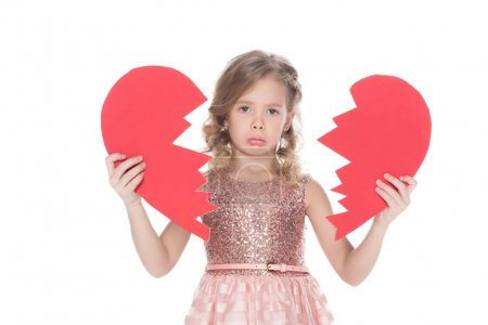 Photo for Upset child holding broken heart, isolated on white - Royalty Free Image