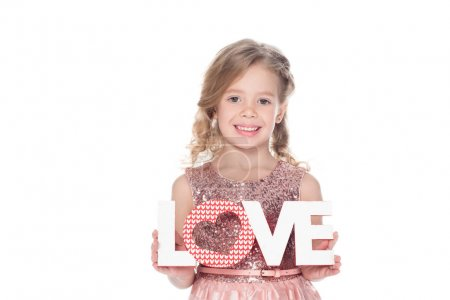 adorable kid holding love symbol with heart for valentines day, isolated on white
