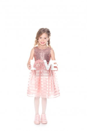 Photo for Beautiful kid holding love symbol for valentines day, isolated on white - Royalty Free Image