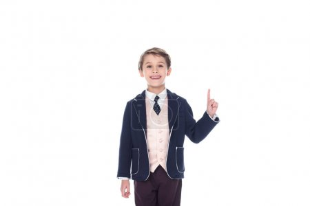 little boy having idea and pointing up, isolated on white