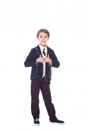 little boy with thumbs up gesture, isolated on white