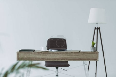 Photo for Chair and wooden table in office isolated on gray - Royalty Free Image