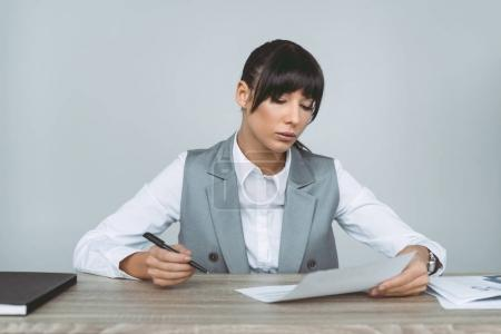 businesswoman signing contract isolated on gray
