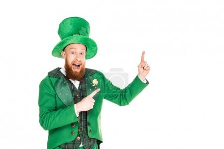 excited handsome leprechaun in green suit and hat presenting something, isolated on white