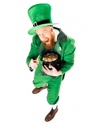 winking leprechaun in green suit holding pot of gold, isolated on white