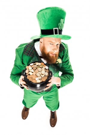 leprechaun in green suit holding pot of gold, isolated on white