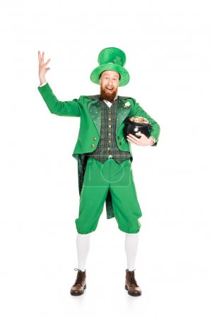excited leprechaun gesturing and holding pot of gold, isolated on white