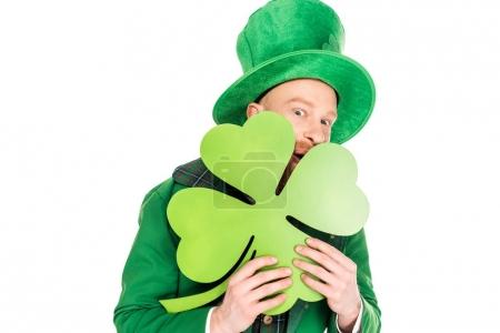 leprechaun in green suit holding clover, isolated on white