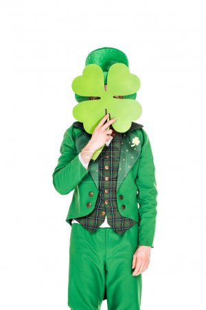leprechaun in green suit holding clover leaf, isolated on white