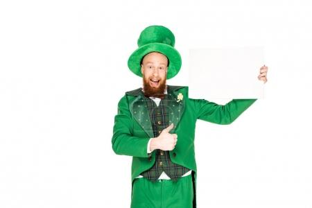 leprechaun with thumb up and blank placard, isolated on white