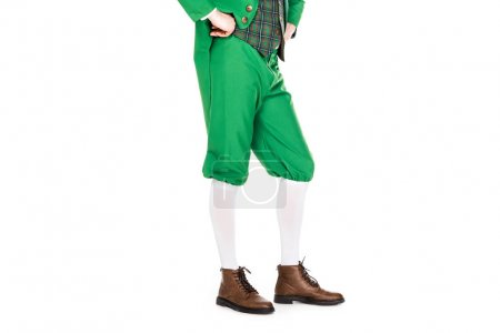 low section of man in green leprechaun costume, isolated on white