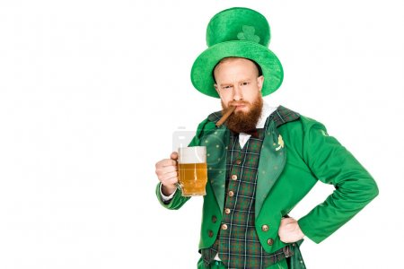 bearded man in green costume holding cigar and glass of beer isolated on white
