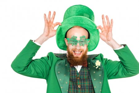 happy bearded man in green costume and hat smiling isolated on white, st patricks day concept