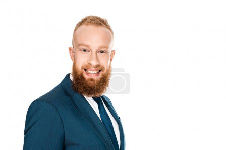 portrait of handsome bearded young businessman smiling at camera isolated on white